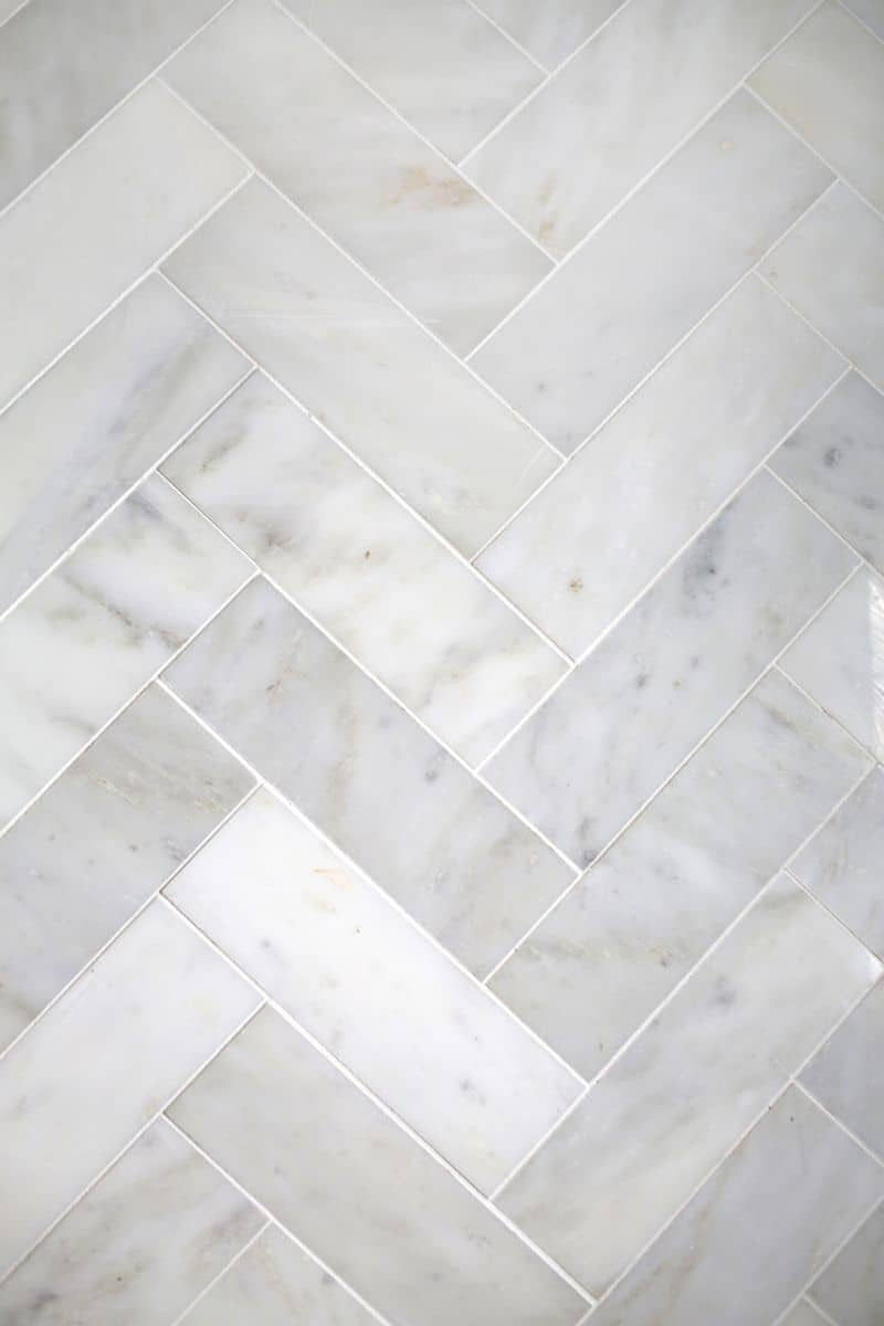 Try This Herringbone Marble Tile A