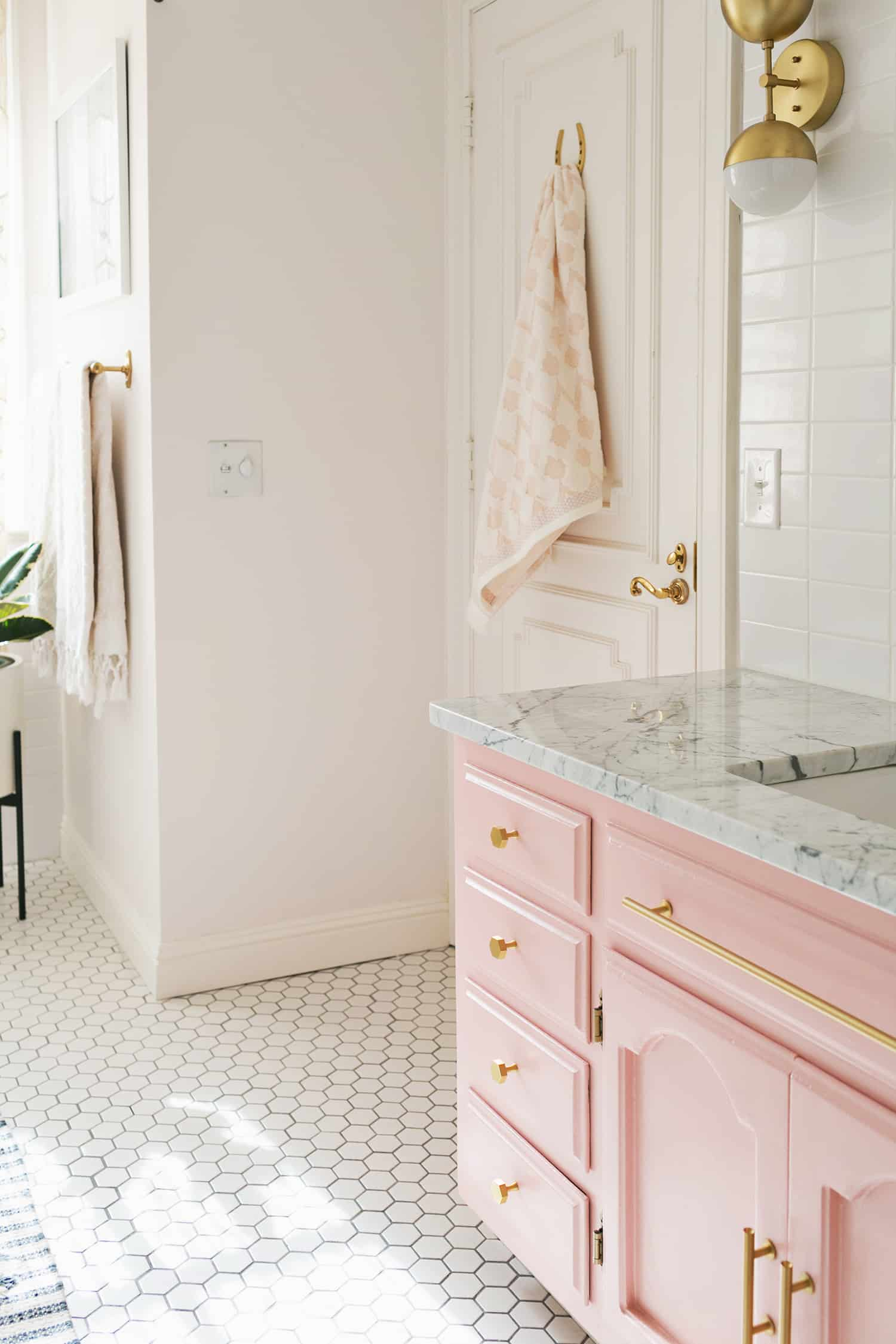 Elsie's Guest Bathroom Tour (Before + After) - A Beautiful Mess on decorating styles 1930 s, tile desgins 1930 s, bathroom tile designs from 1930,