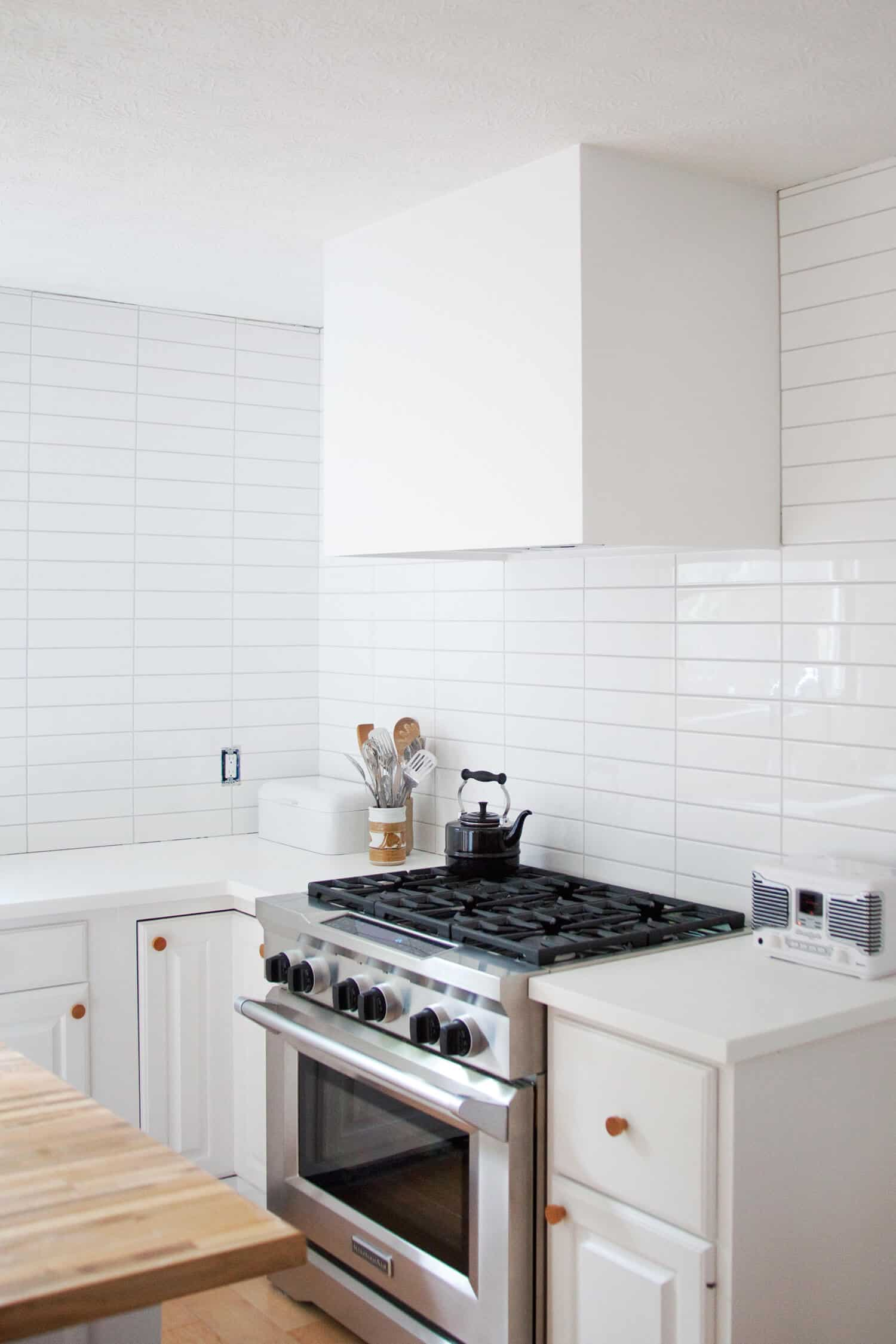 DIY Modern Hood Vent Cover - A Beautiful Mess on kitchen microwave cabinet ideas, kitchen oven cabinet ideas, kitchen refrigerator cabinet ideas, kitchen trash compactor cabinet ideas,