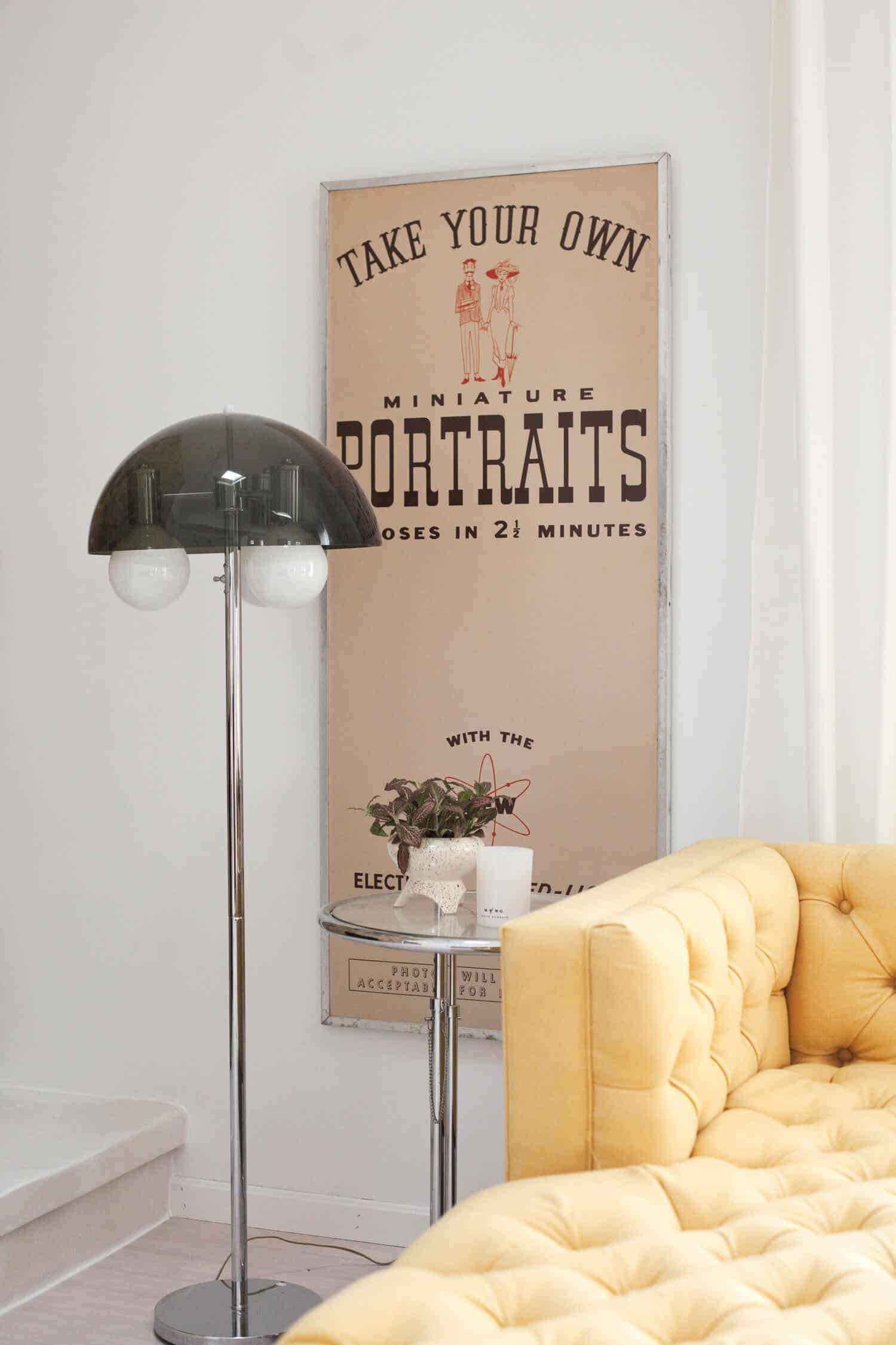 Vintage photobooth panel with Eileen Gray side table