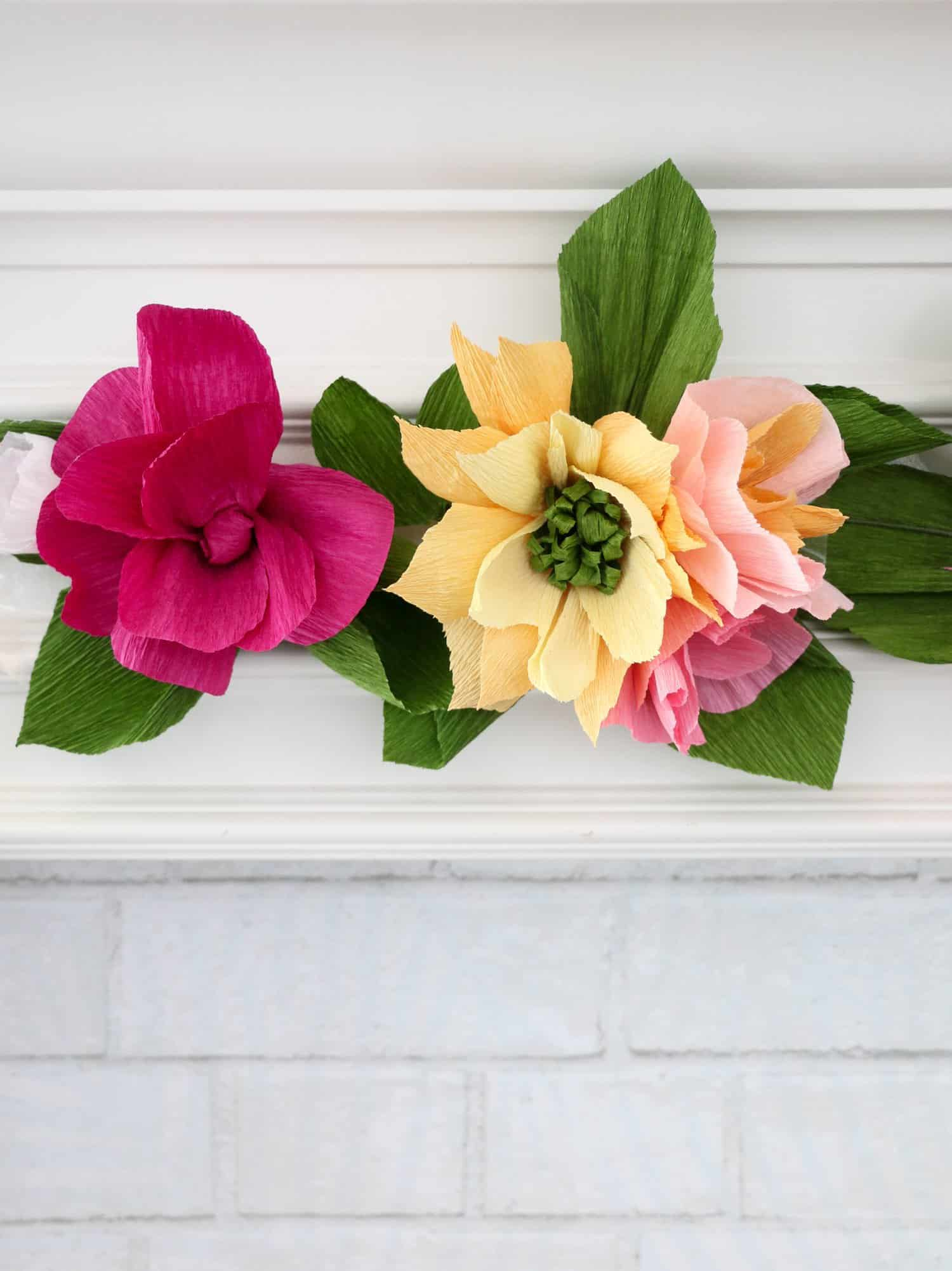 Make a crepe paper flower garland a beautiful mess make a crepe paper flower garland 8 izmirmasajfo