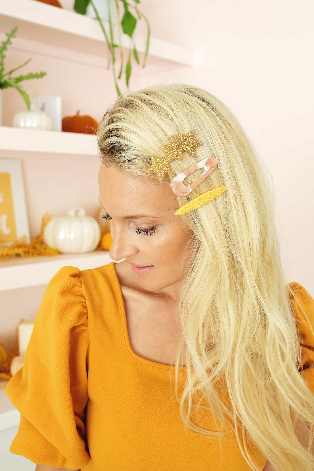 3 statement barrettes in curly hair