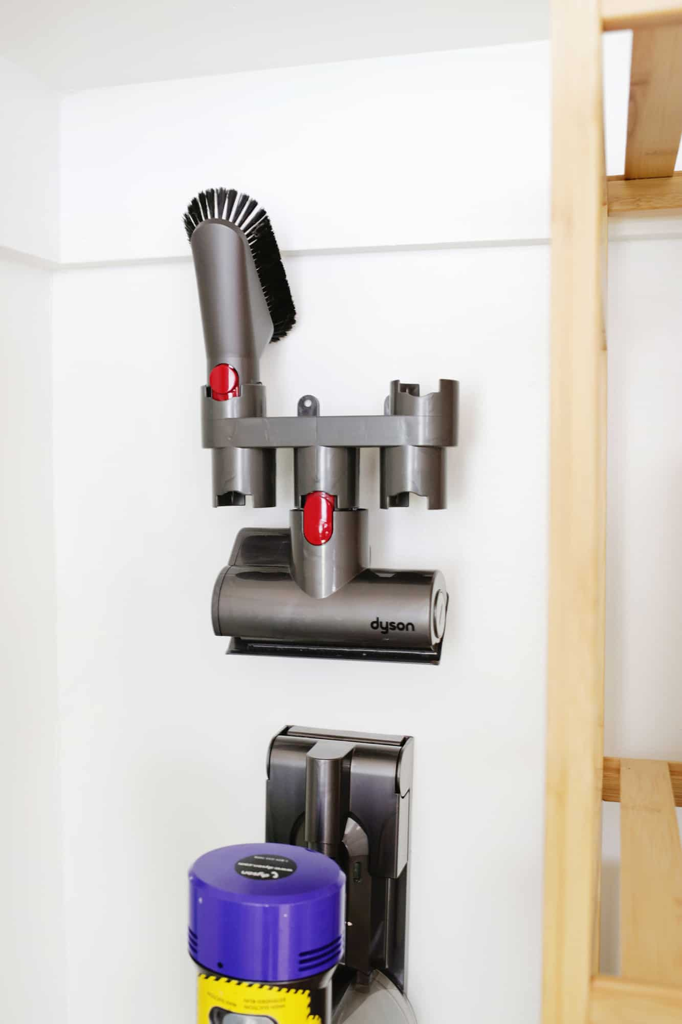 Hanging holder for vacuum attachments