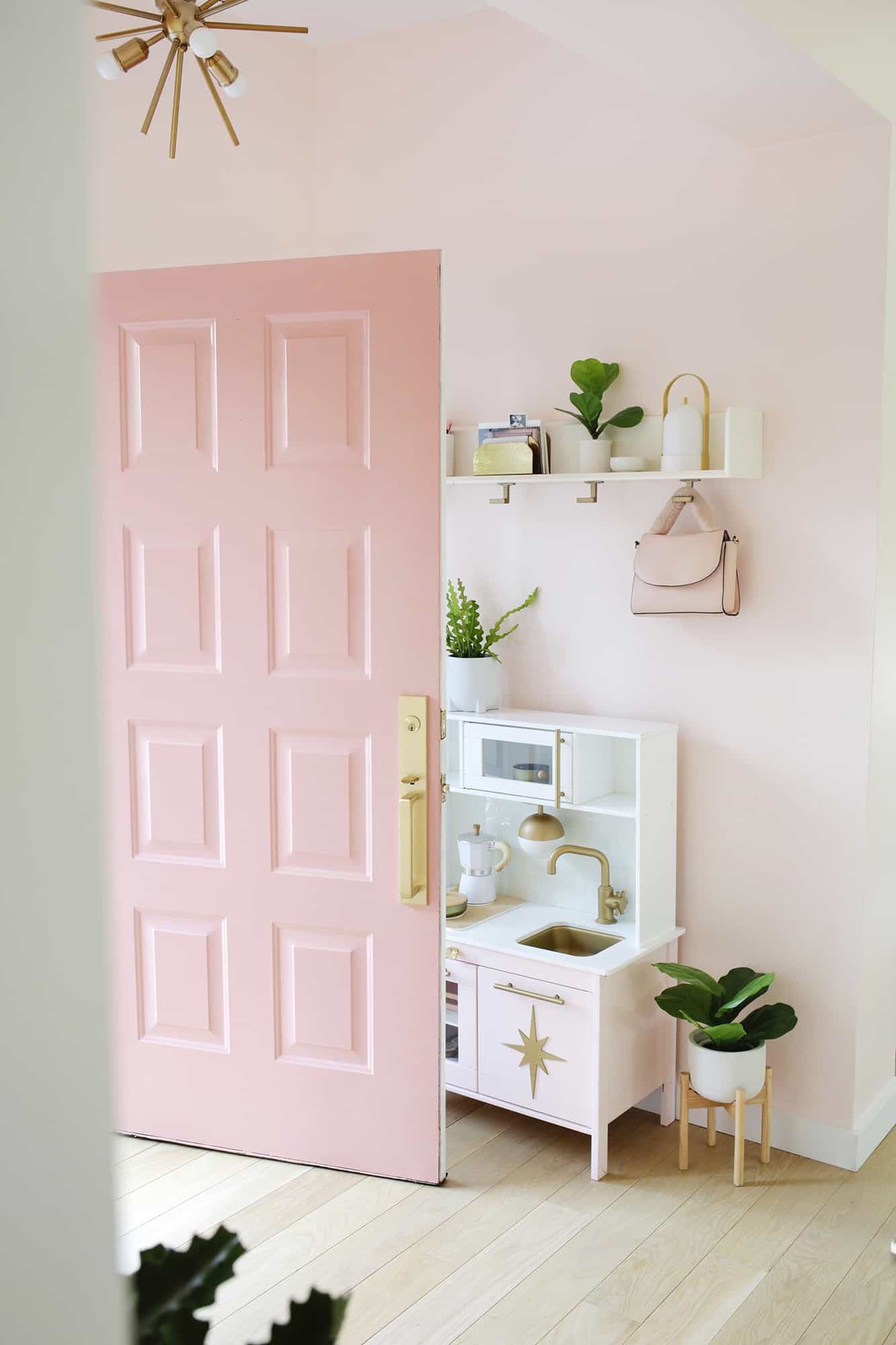 Pink door opening into a pink entryway