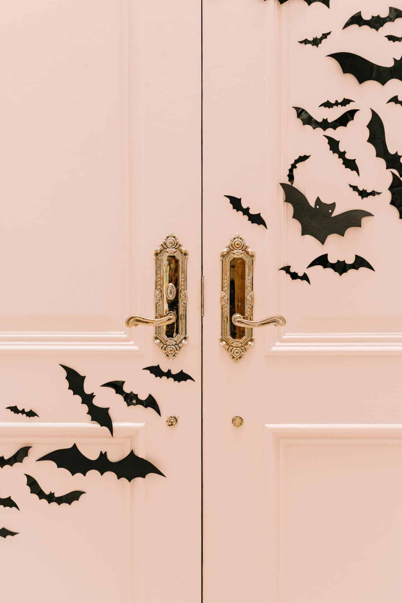 pink door with paper bats on it