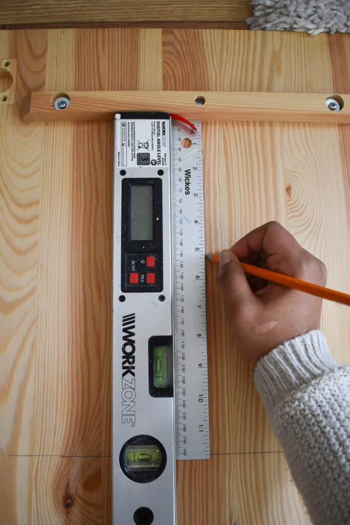 Using an angle ruler or level