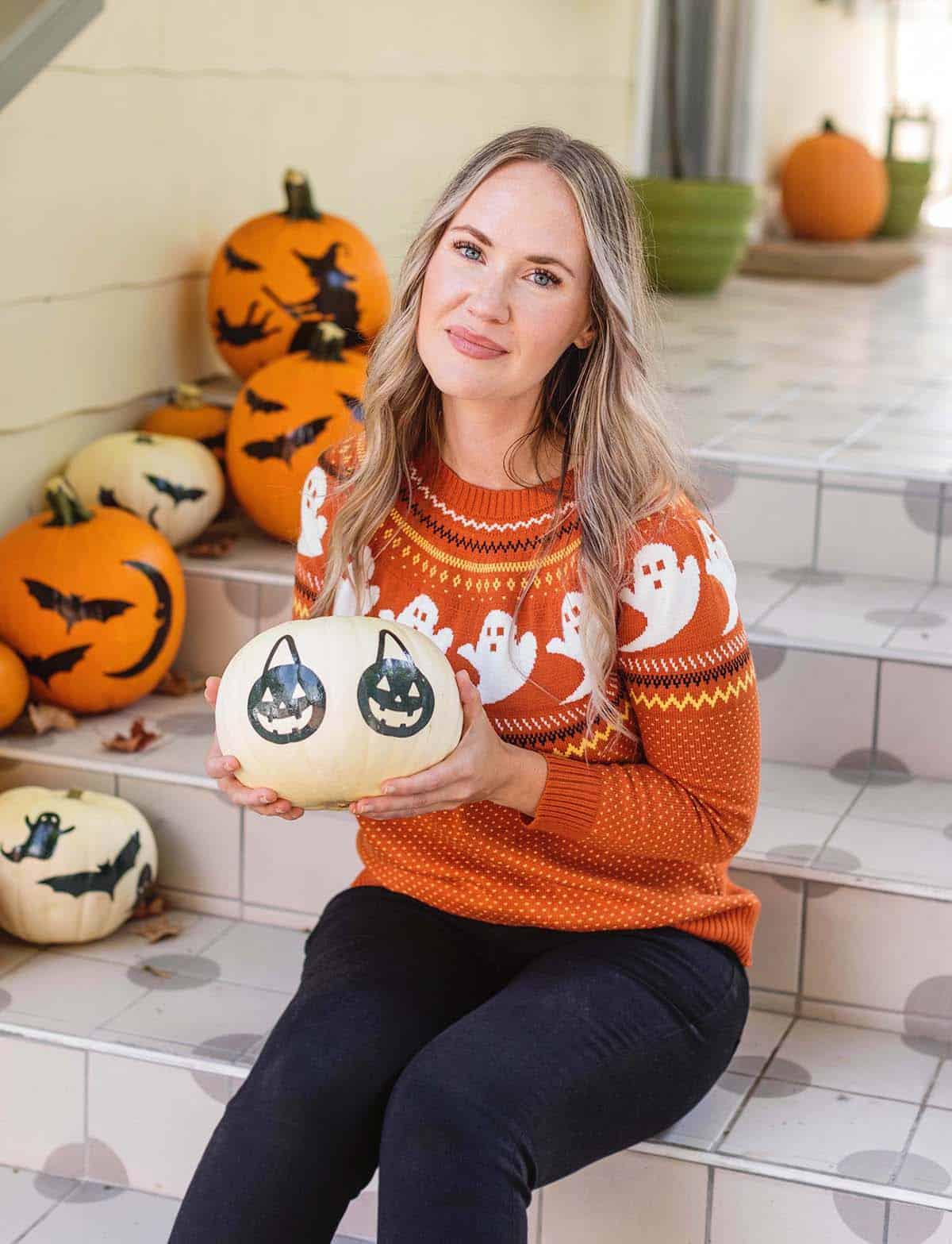 Emma holding a pumpkin