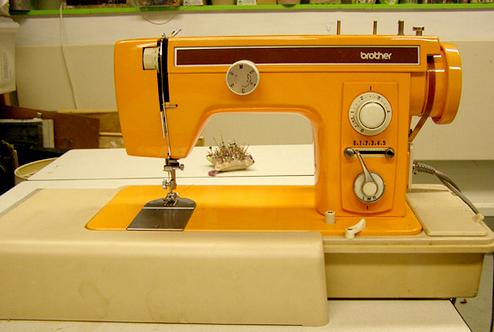 Orange-colored-sewing-machine