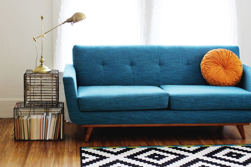 Metal Crate Coffee Table + Thrive Furniture Couch (via A Beautiful Mess)