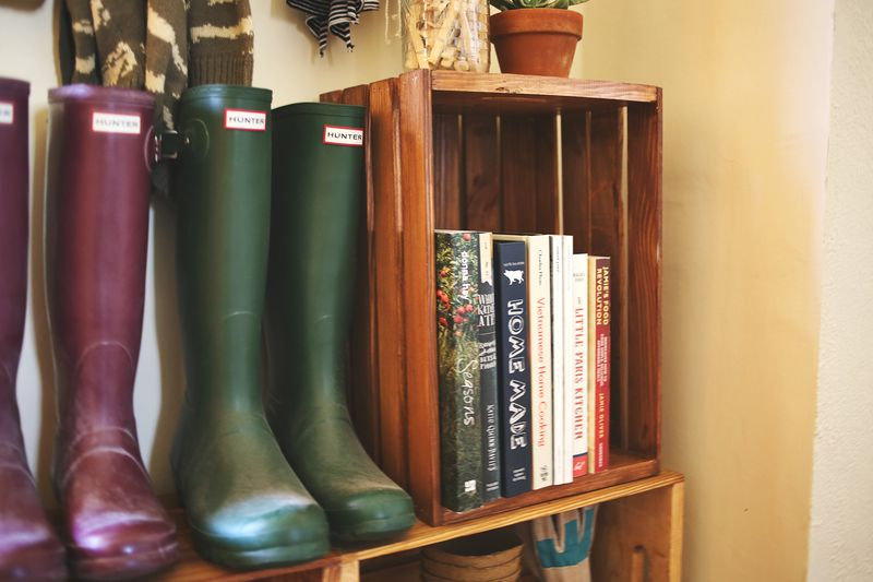 Crates as shelves in the mudroom