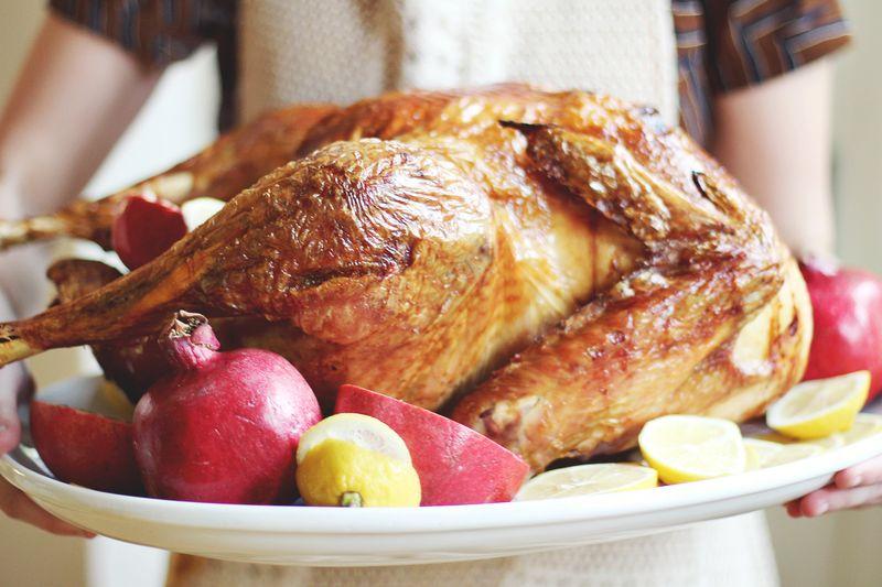 Thanksgiving turkey garnished with lemons and pomegranates