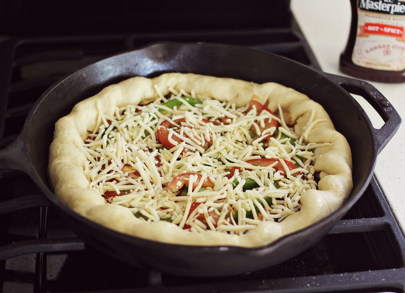 Try this-bake a pizza in a cast iron pan