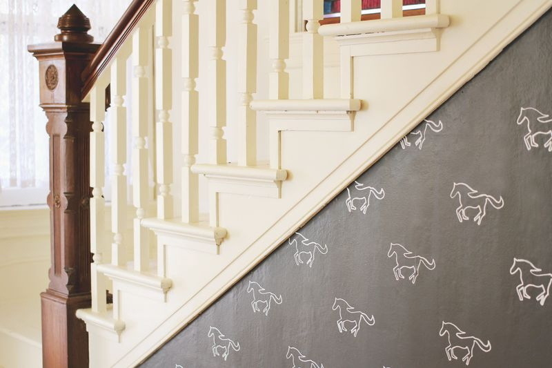 White painted stairs + stenciled statement wall
