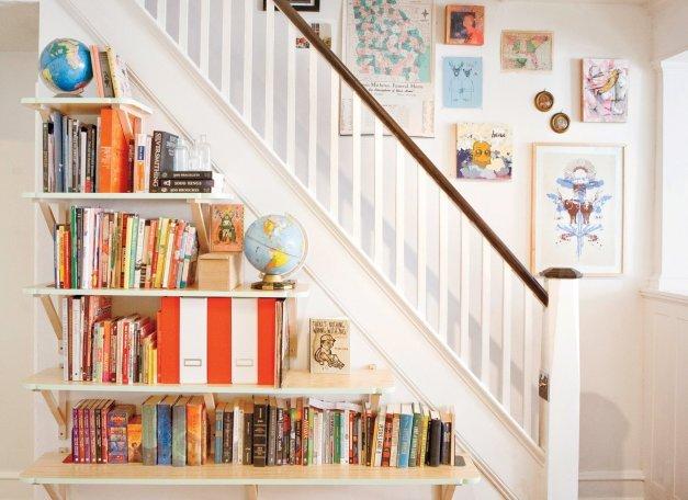 Bookshelves beneath stairs