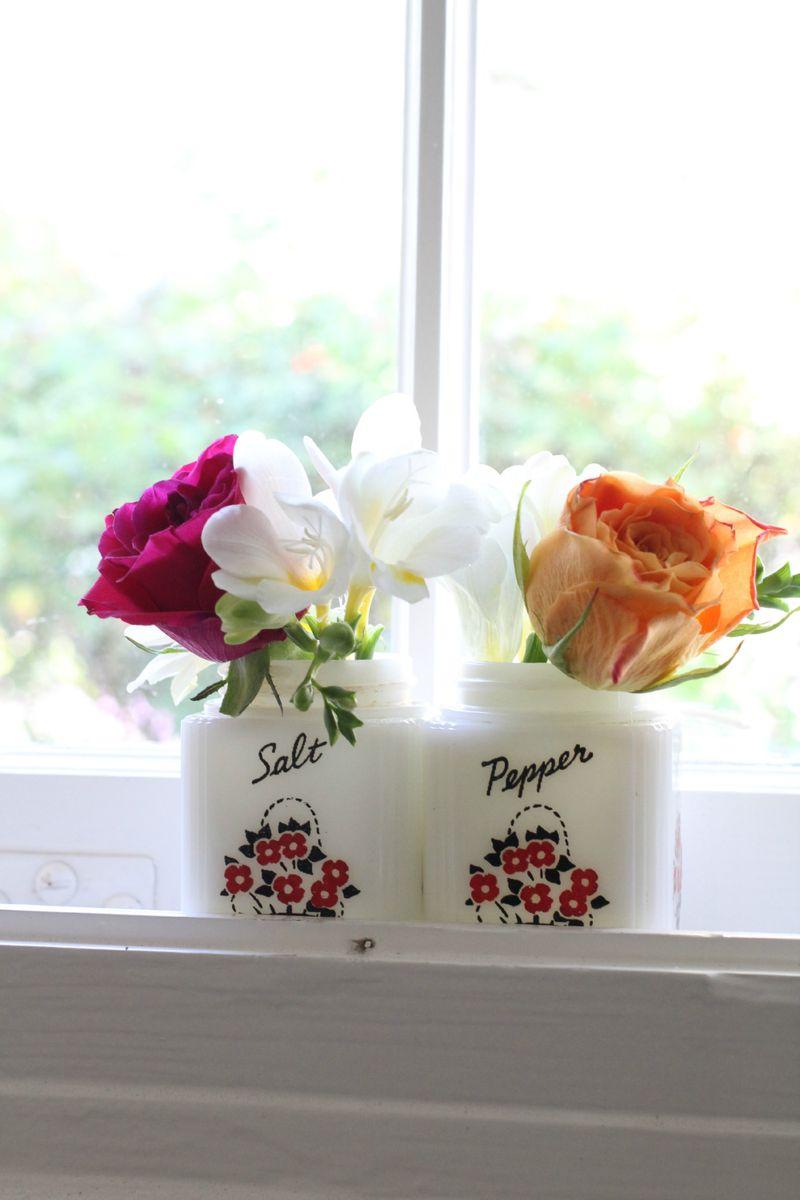 Fresh flowers in vintage S&P shakers