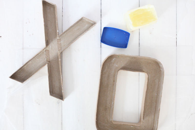 Make these concrete letter candlestick holders for a centerpiece at a party or wedding. Click through for dos & don'ts of forming concrete.