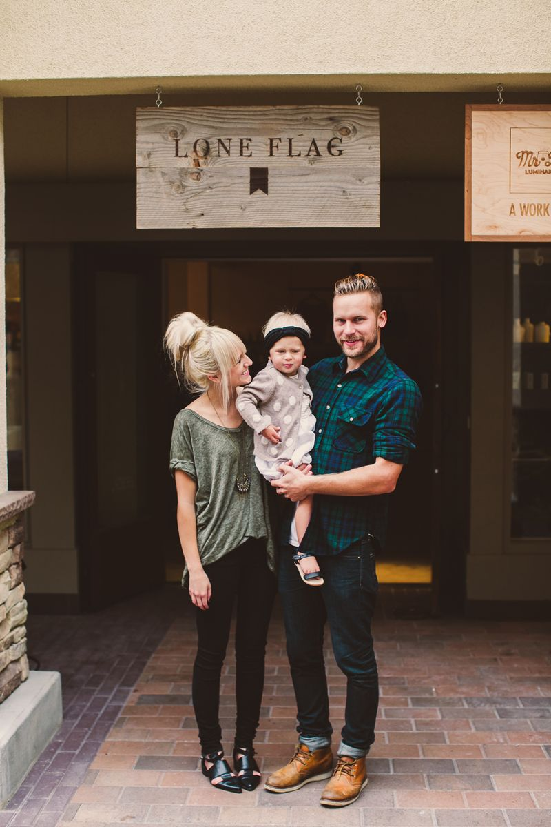 Sweet family outside their CA shop, Lone Flag