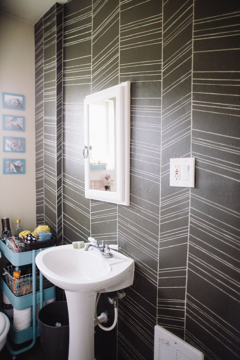 Love the bold walls in this bathroom!