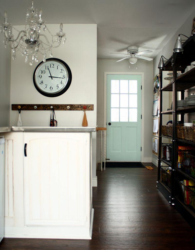 Love that chandelier and mint door!