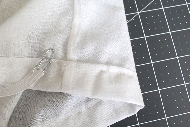 Attach a paper clip or safety pin to the elastic