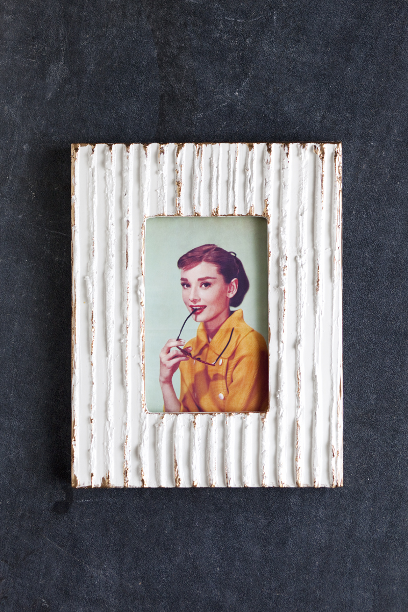 Make a textured picture frame- this would be great in a gallery wall!