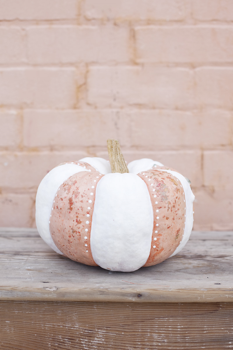 white striped painted pumpkin