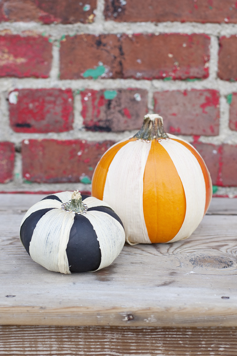 use corn husks to make striped pumpkins