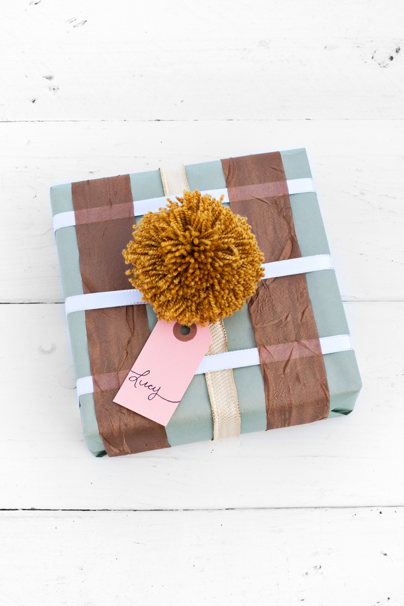 Use scrap pieces of ribbon to make a plaid design on your wrapped gifts.