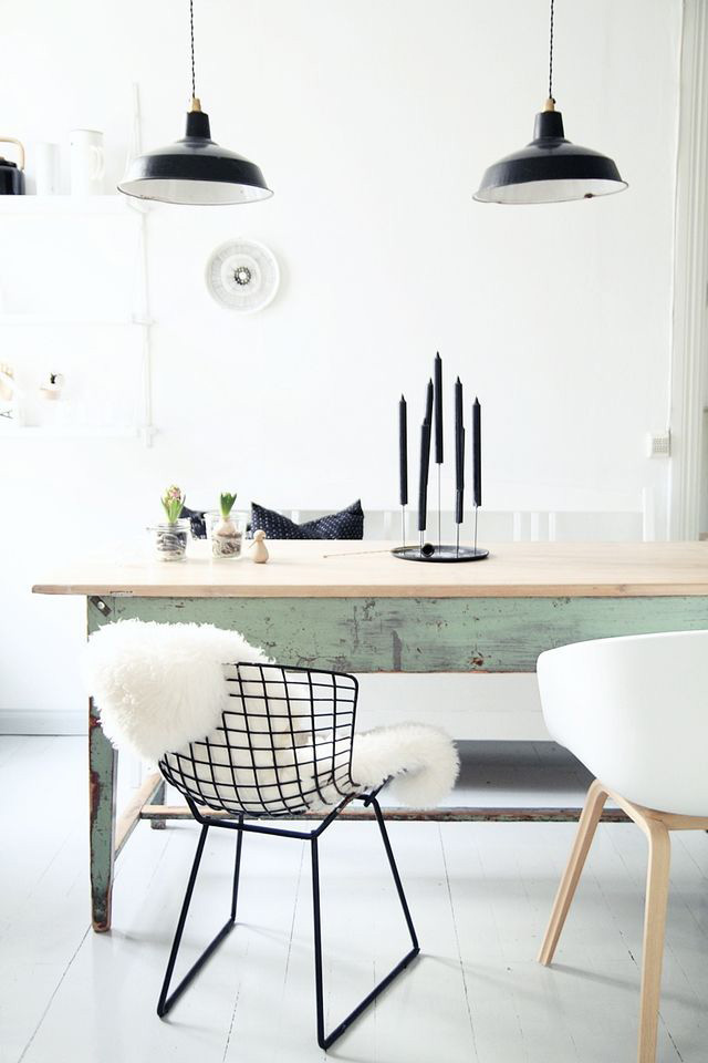 Simple Scandinavian dining room with lots of white and touches of green and black