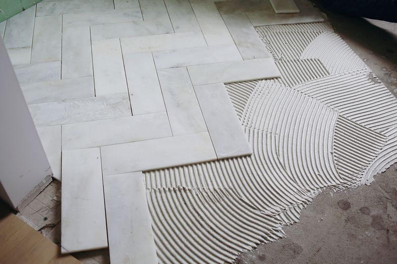 Cut 12x12 marble into 4x12 strips for herringbone pattern