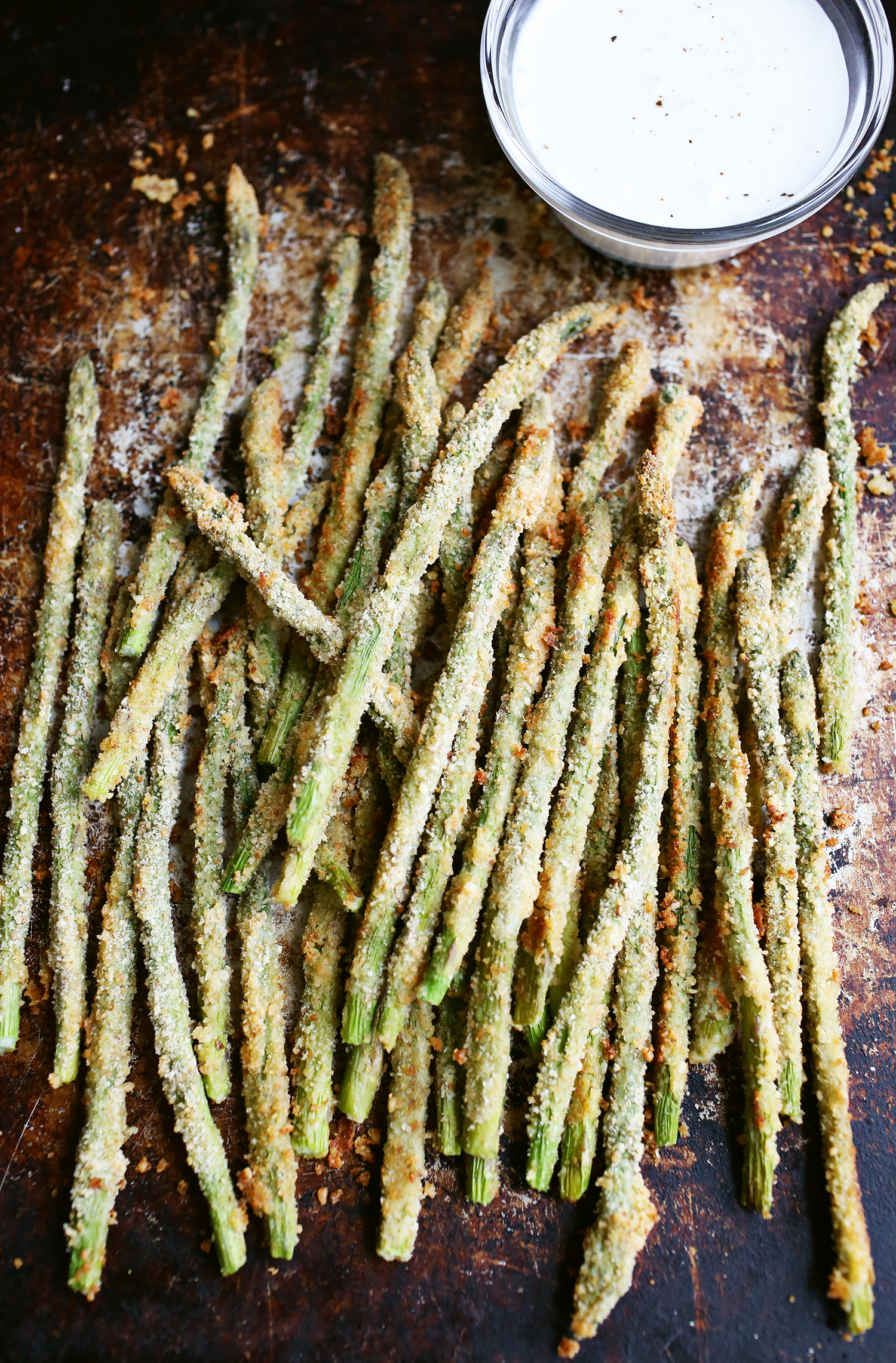 Baked asparagus fries with creamy lemon sauce