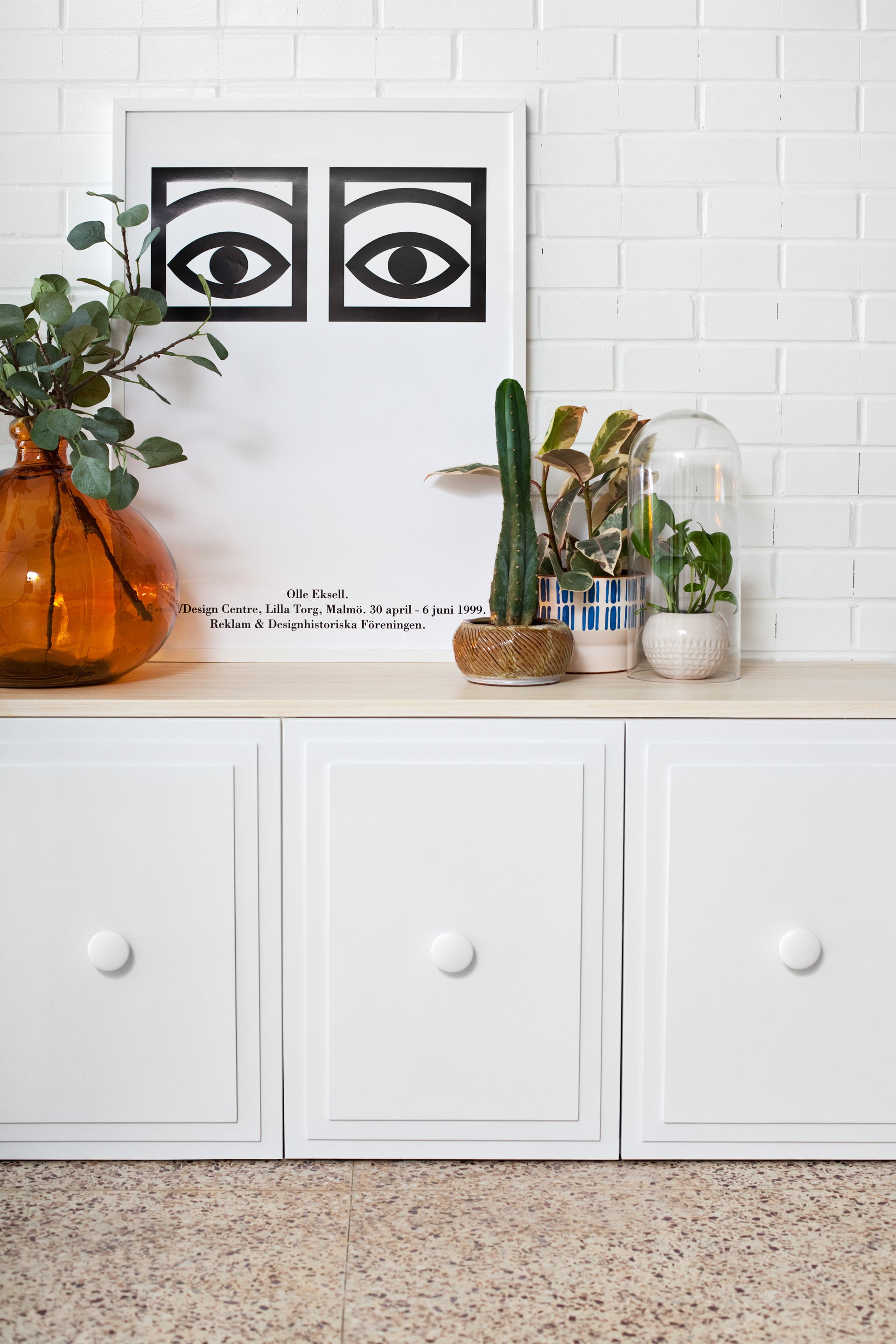 Modern Regency Cabinet made from plain white Ikea cabinets! Click through for the tutorial.
