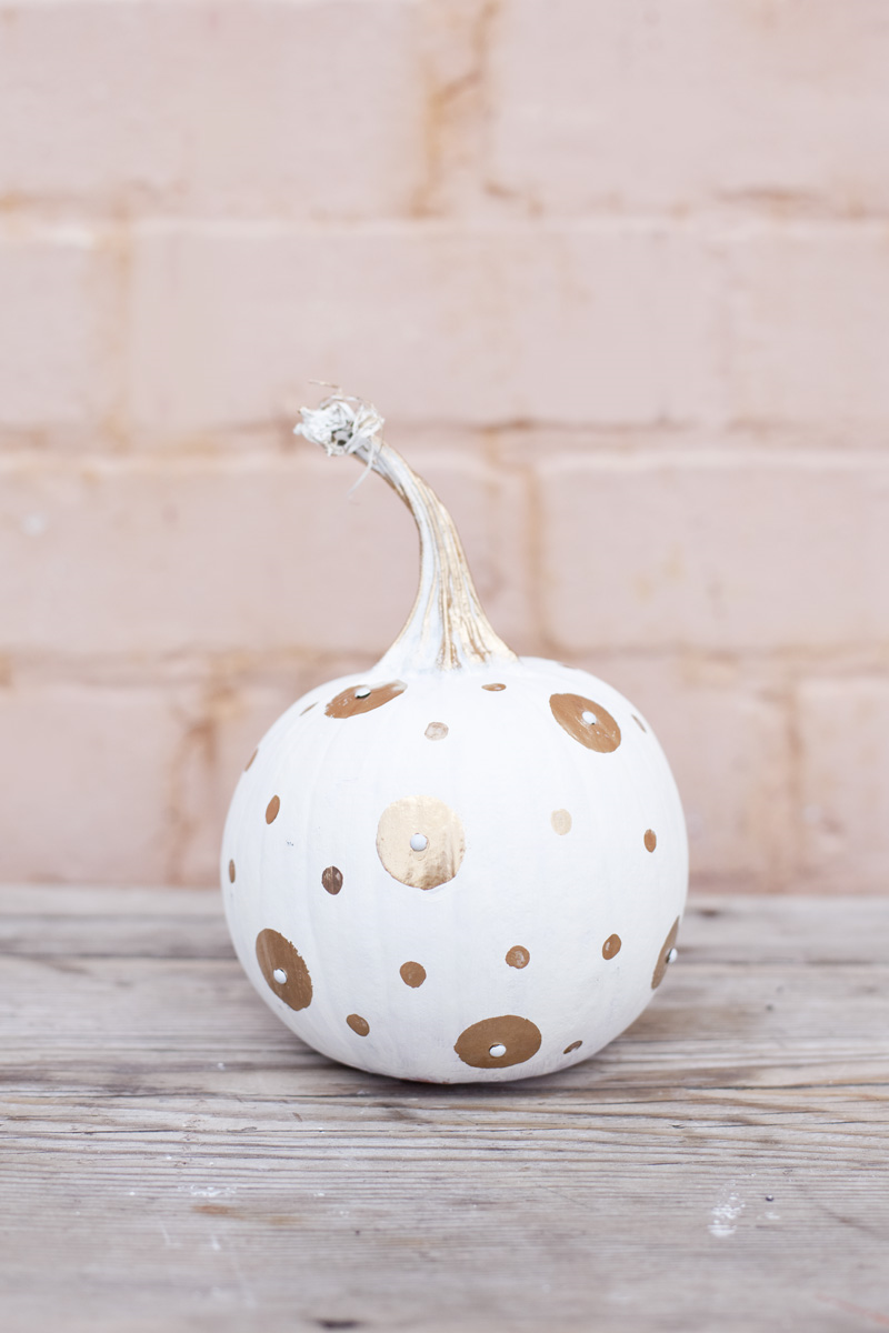 white and gold painted pumpkin