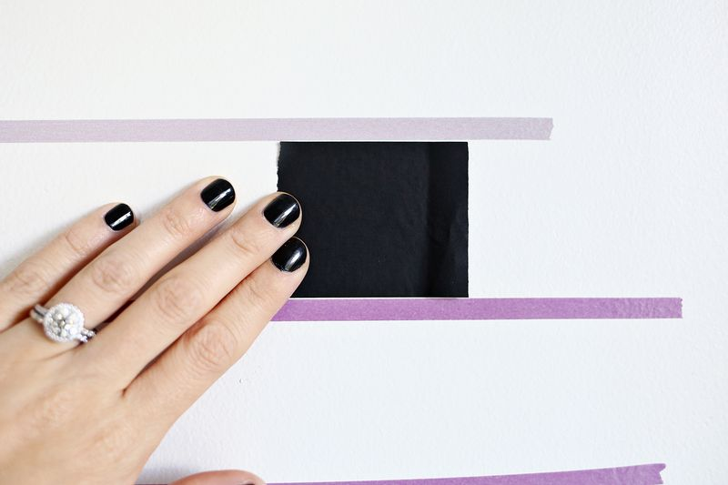 Make a removeable wall design with squares of washi tape! (click through for tutorial)