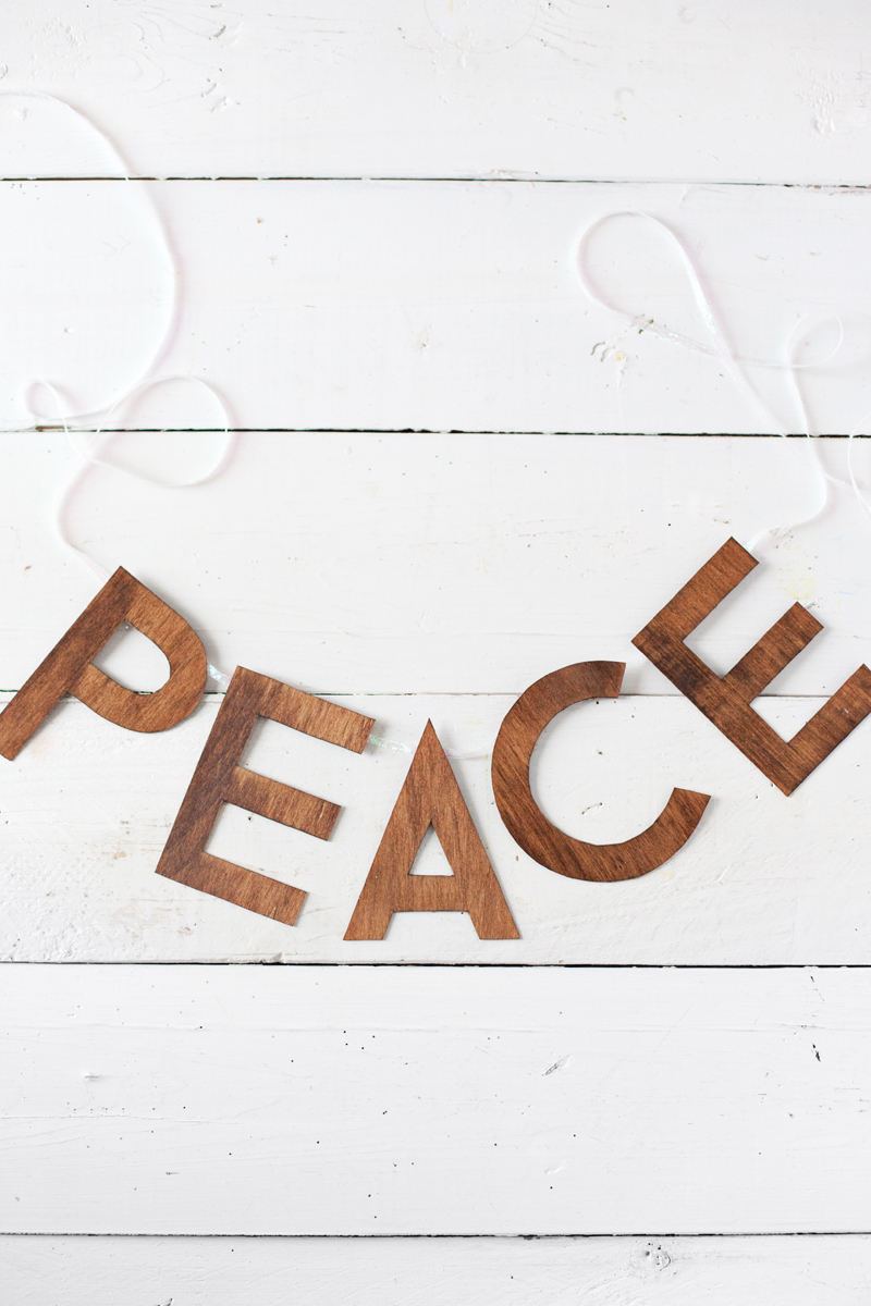 Five homemade holiday garlands to make this season— including this wooden peace garland