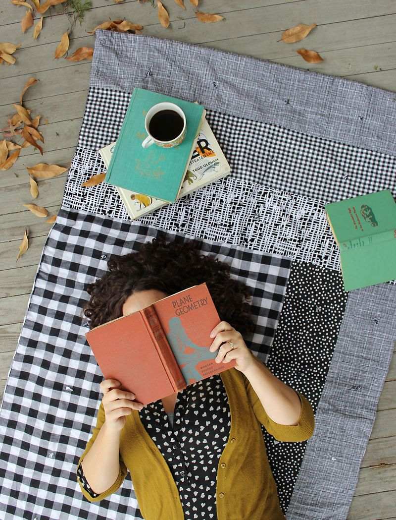 Learn to make an easy patchwork lap quilt on www.aBeautifulMess.com today