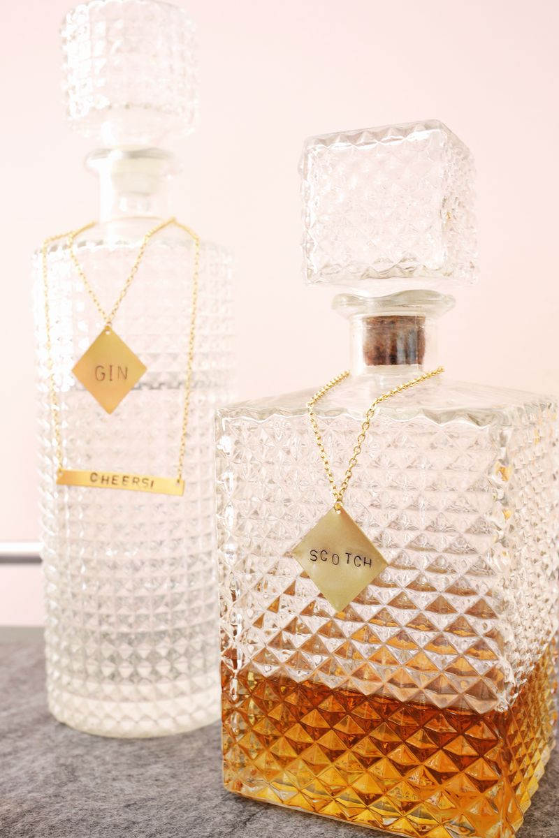 Stamped metal tags for glass decanters-so pretty! (click through for tutorial)