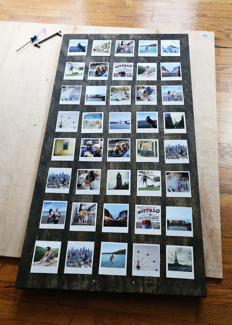 Taping down the photos